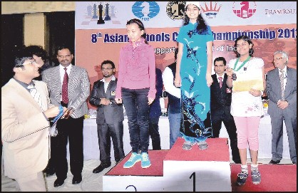 Manasa posing with her bronze medal at the Asian Schools Chess Championship at Delhi.