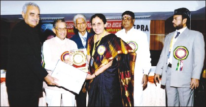 Dr. Paniveni Udayshankar is seen receiving the Indira Gandhi Sadbhavana Award from former Union Minister M.V. Rajashekharan at a function held in Bangalore recently. Agriculture University Vice-Chancellor Dr. Narayana Gowda GEPRA Secretary Pasha and others look on.