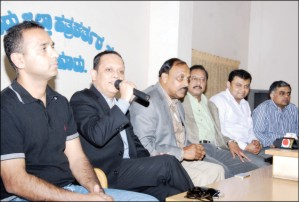 AKKA Convenor Suresh Babu is seen addressing a press meet at Pathrakarthara Bhavan here this morning. Others seen are (from left) AKKA Joint Secretary Ravi Boregowda, President Dr. Halekote Vishwamitra, Founder and Treasurer Amaranath Gowda, Joint Treasurer Dr. Naveen Krishna and Vice-President Raja Patil.