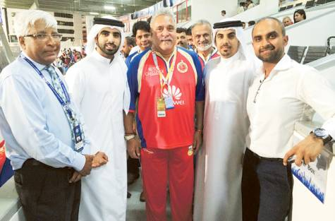 Vijay Mallya with Khalaf and Waleed Bukhatir, sons of Abdul Rahman Bukhatir, at the Sharjah Cricket Stadium. / Image Credit: COURTESY: SCC