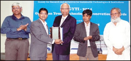 Rajiv Ranjan, Junior Researcher at CSIR-CFTRI, is seen receiving the national award from eminent scientist Dr. R. A. Mashelkar at a function in Ahmedabad recently as others look on.