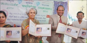 Pramoda Devi Wadiyar is seen releasing the Special Cover at Postal Training Centre (PTC) in Nazarbad this morning as (from left) Aindri Anurag, Postmaster General, South Karnataka Circle, Bangalore, M.S. Ramanujan, Chief Postmaster General, Karnataka Circle and N.S. Dwarkanath, President of Mysore Philatelists' Association, look on.