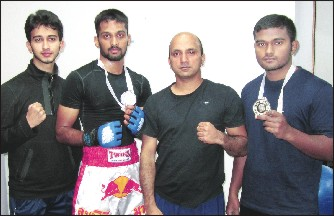 Seen in the picture are (from left) Chandan, Basavesh, Trainer Samith Bhat and Karthik.