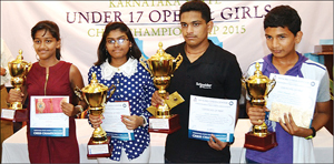 The winners in the U-17 open and girls Karnataka State Chess Championships conducted by the Mysuru Chess Centre at the Hotel Dasprakash premises seen with the trophies. Standing from left: Khushi M. Hombal, H.R. Manasa, Ojas Kulkarni and P. Shet Prajwal