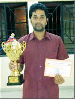 Y.G. Vijayeendra, winner of the Open category title, seen with the trophy