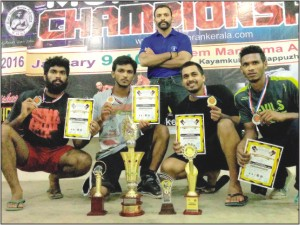 Seen in the picture are Muay Boran Champions (from left - squatting) Harish S. Gouli, B. Ravi, K.G. Prajwal Deep & A.M. Arjun with Coach KRU. Chethan M. Ashwathama (standing).