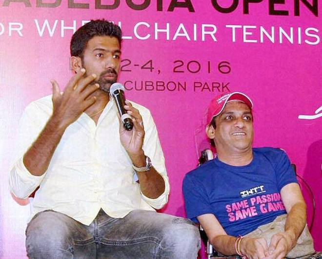 Rohan Bopanna speaks at the launch of Indian Wheelchair Tennis Tour's Tabebuia Open in Bengaluru on Tuesday, along side Sunil Jain, founder-trustee of ASTHA.