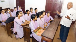 Narayana Nayak briefing students about scholarships and other facilities that they are entitled to, at Balmatta First Grade College for Women in Mangaluru |Rajesh Shetty Ballalbagh
