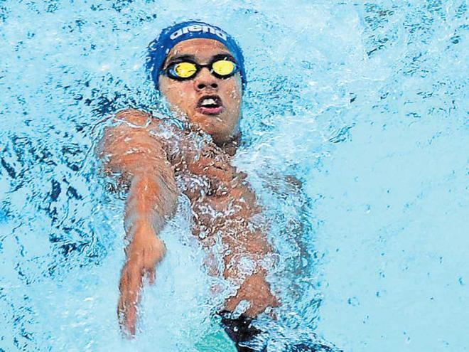 big splash Srihari Natraj of GSC en route to the 100M backstroke gold at BAC in Bengaluru on Tuesday. DH photo