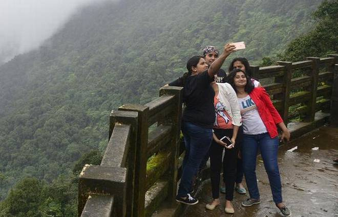 A selfie moment at Agumbe view point in Western Ghats of Karnataka. | Photo Credit: K. Murali Kumar
