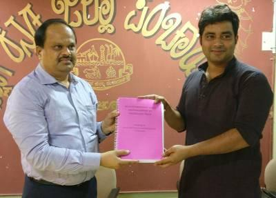 Vineet Alva, managing trustee, AEF (right) hands over report of asset mapping of 55 GPs of Mangaluru taluk carried out by AIET staff/students to M R Ravi, CEO, DK ZP in Mangaluru on Saturday / Pic: Jaideep Shenoy