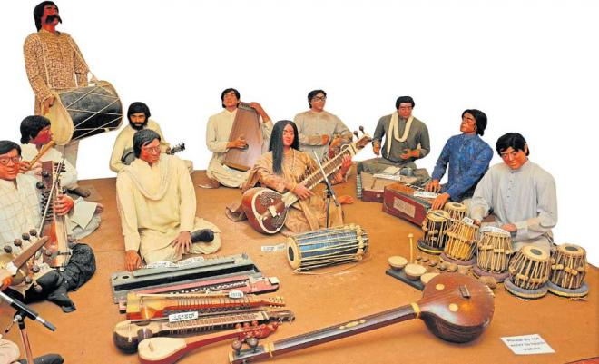 Perfect blend: Wax statues of musicians at the Melody World Wax Museum in Mysuru. DH Photo