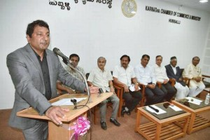Prabhu Patil, CEO of Prolim Global Corporation, addressing a gathering after being felicitated by Karnataka Chamber of Commerce and Industry in Hubballi on Tuesday.