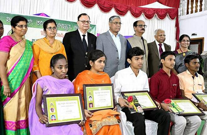 The five meritorious students selected for the Dr. P.S. Shankar Medical Students Scholarship after being felicitated in Kalaburagi on Monday.