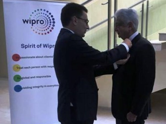 Wipro Limited Chairman Azim Premji receives the highest French civilian distinction, Chevalier de la Legion d'Honneur (Knight of the Legion of Honour), from Ambassador of France to India Alexandre Ziegler, in Bengaluru on Thursday.