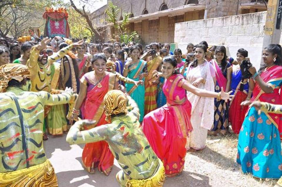 Students of the Government College for Women participating in 'Janapada Jatre' in Mandya on Tuesday.