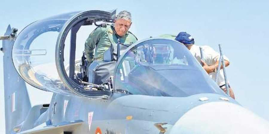 Army chief Gen Bipin Rawat gets into the cockpit of the Light Combat Aircraft Tejas during the Aero India show on Thursday | Nagaraja Gadekal