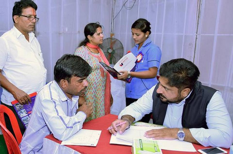 Vikram Siddareddy, general surgeon and director of United Hospital, counselling a patient during a free health check-up camp at United Hospital in Kalaburagi on Tuesday. | Photo Credit: ARUN KULKARNI